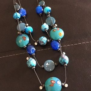 Turquoise & blue stones! Black silver.